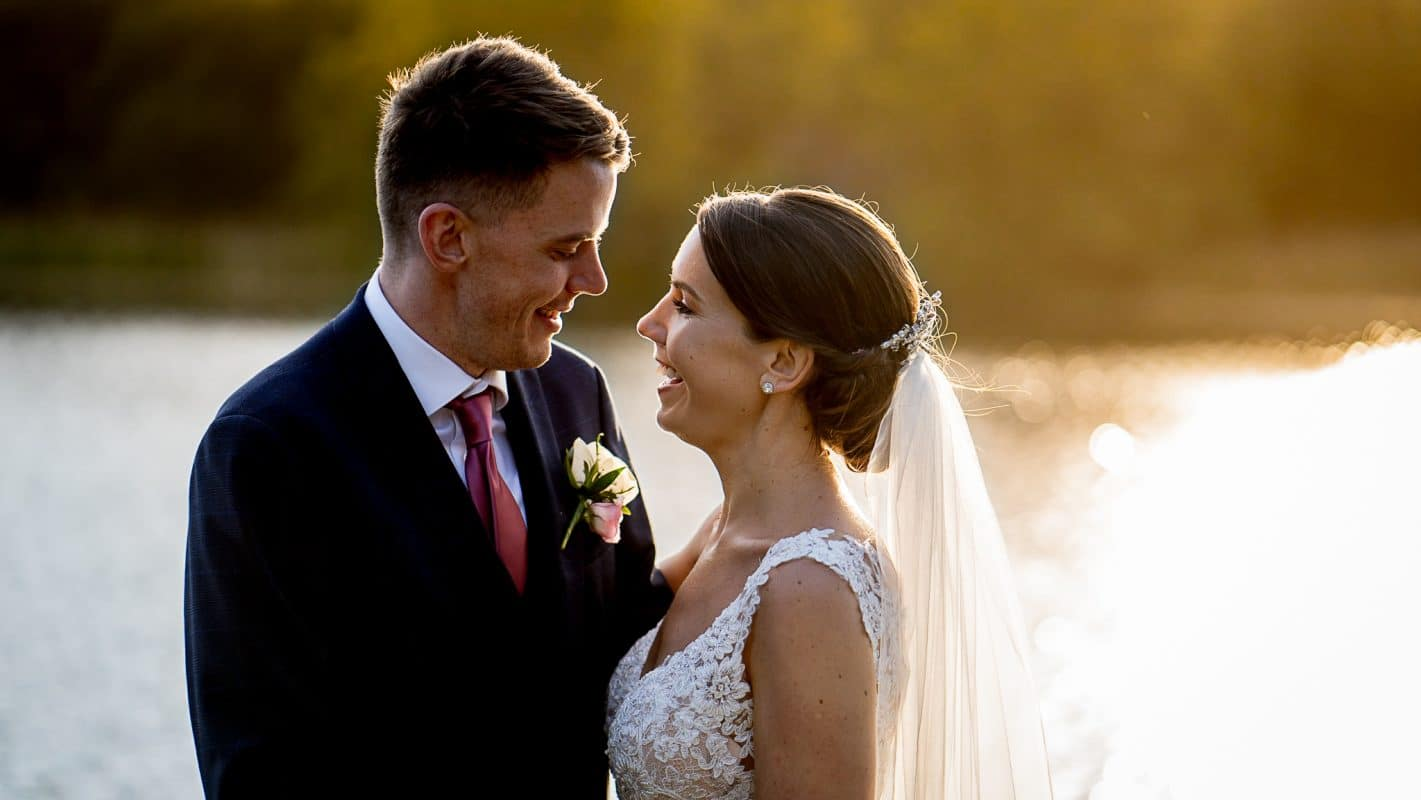 Hensol Castle wedding photography of bride and groom at the jetty in the summer