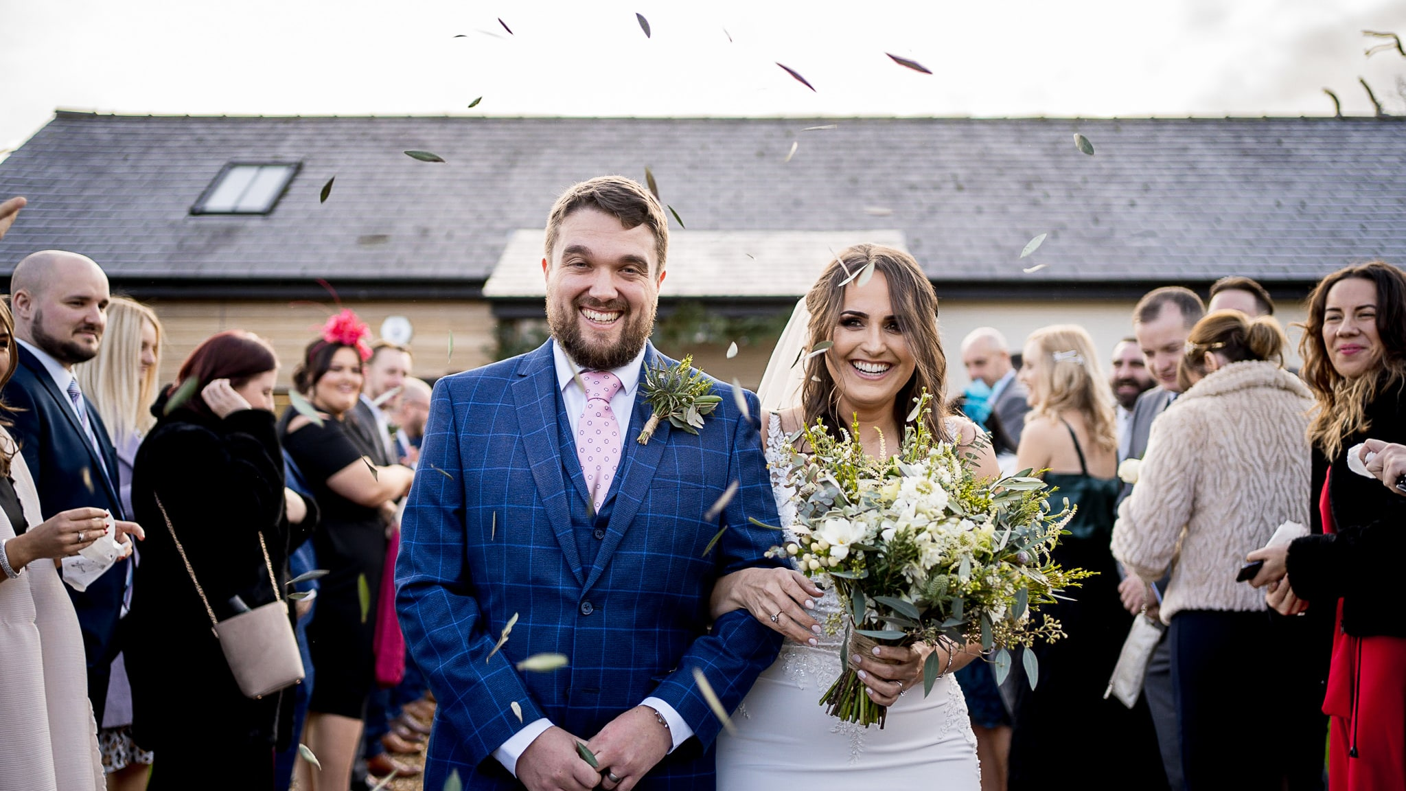 Wedding photographer capturing bride and groom during confetti at Oldwalls and Fairyhill in the Gower