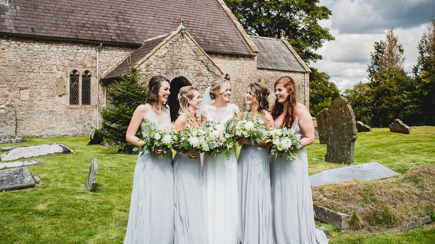 bridesmaids with bride at the wedding