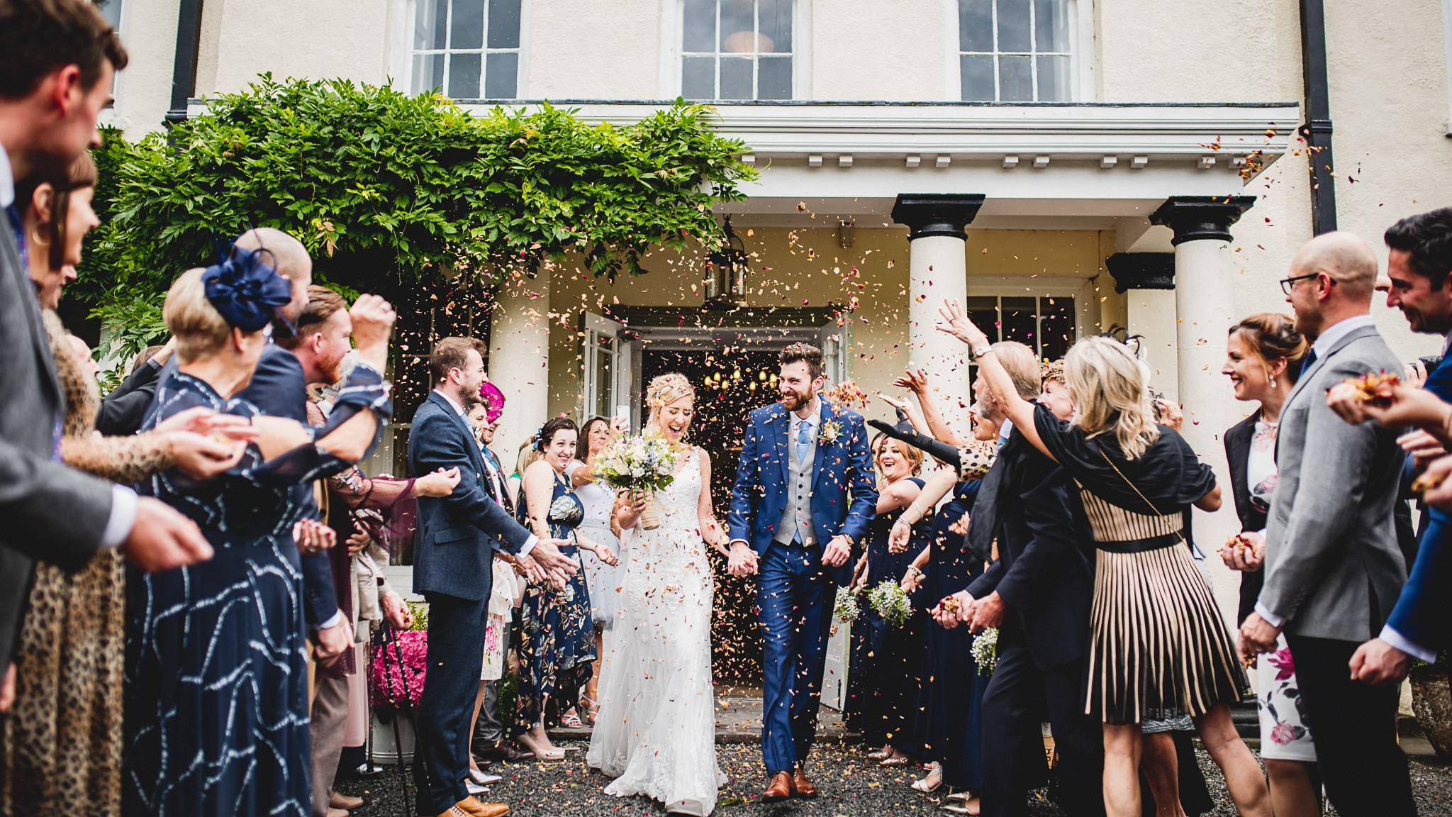 Confetti thrown over couple during their Swansea wedding photography